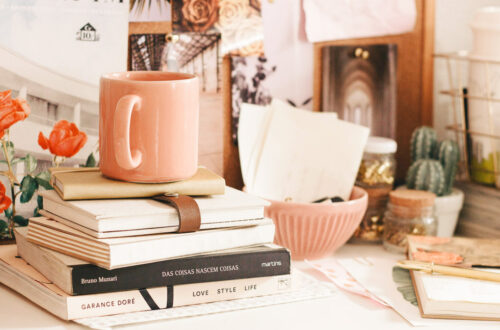 cups and books on a desk
